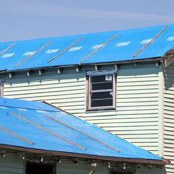 New Orleans, LA, February 27, 2006 - FEMA provided blue plastic sheeting  to temporarily protect roofs damaged by hurricane winds until the homeowner can repair or replace the damaged roof.  Some structures, still in need of repair, continue to rely on the blue roof covering well after the 30 day warranty period.  Robert Kaufmann/FEMA