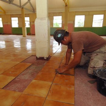051224-N-4374S-002 Victoria, Seychelles (Dec. 24, 2005) - Builder 3rd Class Jonathan Martinez,  assigned to Naval Mobile Construction Battalion Three (NMCB-3), applies a ceramic floor tile during the restoration project at the Providence Hall in St. Elisabeth Convent, a daycare center in  Seychelles.  The NMCB-3 Seabees attached to Bahrain deployed to the island of Mahe, Seychelles to provide general engineering construction and renovation of orphanages. U.S. Navy photo by PhotographerÕs Mate 2nd Class Michael Sandberg (RELEASED)